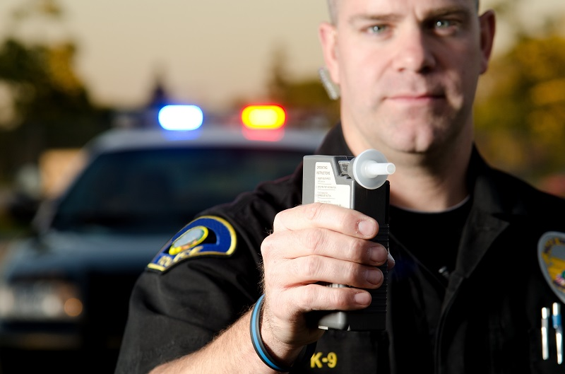 Police administering breathalyzer test in New Jersey | Shapiro & Sternlieb, LLC
